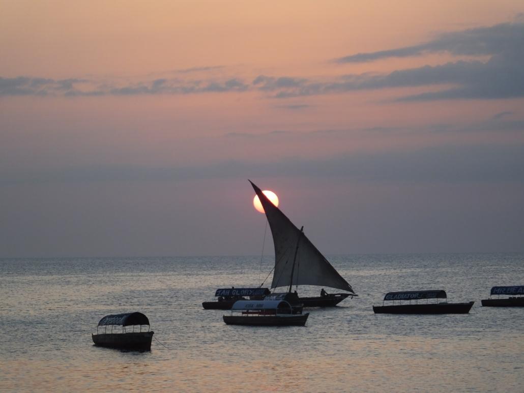 Sun setting behind a dhow (Zanzibar)