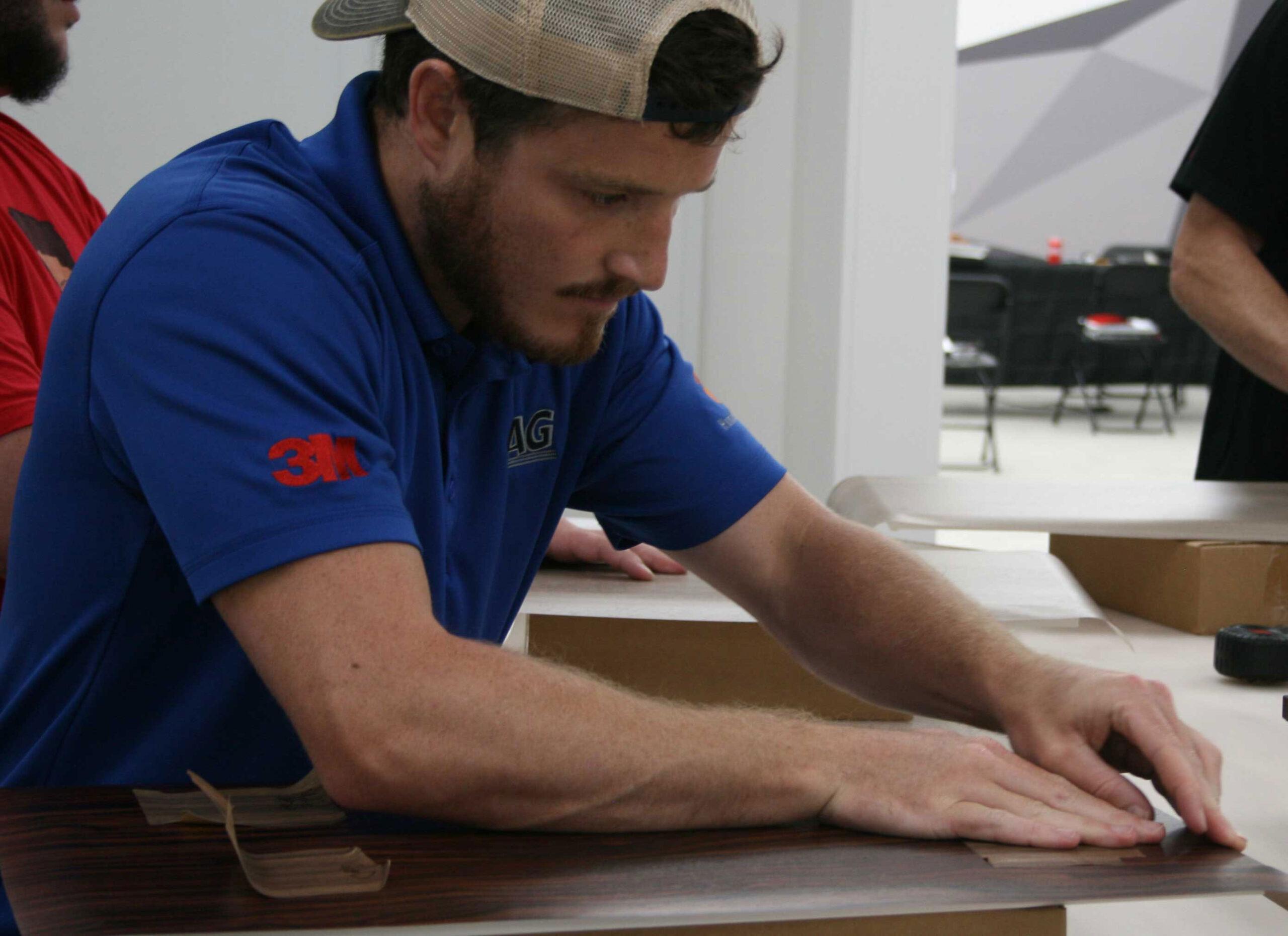 Tyler Gadient installing window tint