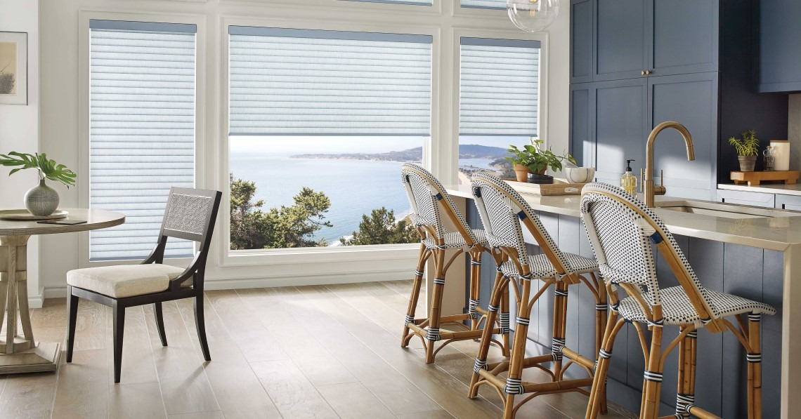Navy and white kitchen/dining room with vertical blinds over window with water view