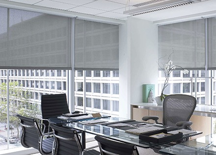 Well-lit office with windows and blinds