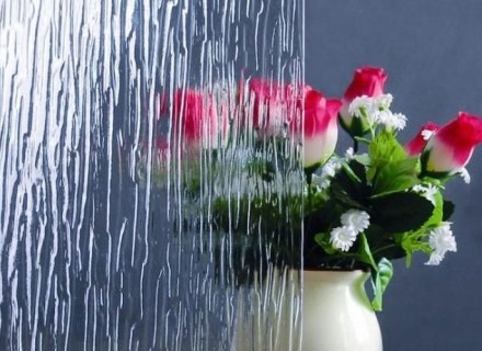 Bouquet of flowers half hidden behind textured clear window film