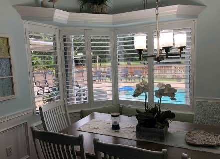 Installed on a dining room window, plantation shutters window treatment are a popular product JAG installs in Rocklege and Viera to add privacy.