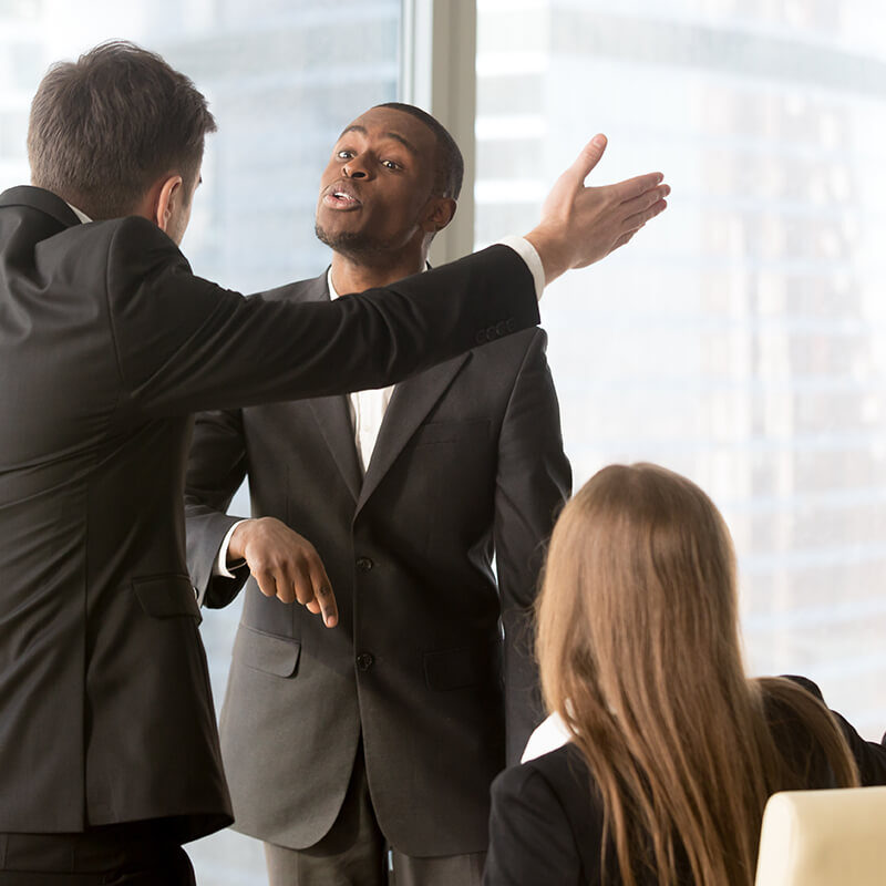 annoyed-business-partners-arguing-during-meeting-1