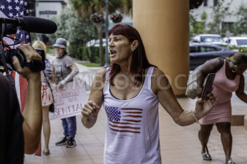 News media interviewing an angry female protester