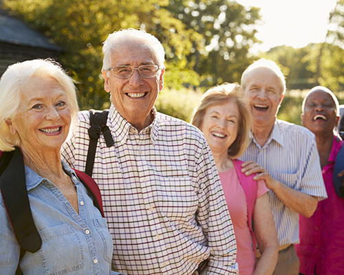 Portrait Of Senior Friends Hiking In Countryside