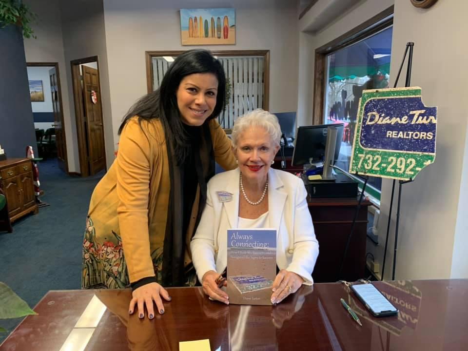 Diane Turton of Diane Turton Realtors with 'The Sign'