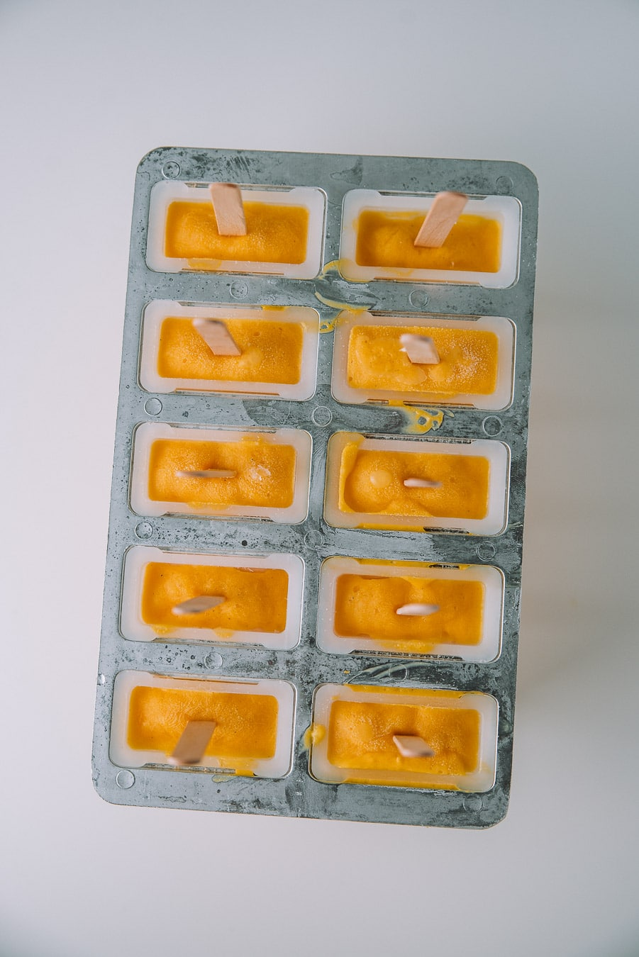 mango lassi popsicles in popsicle mold