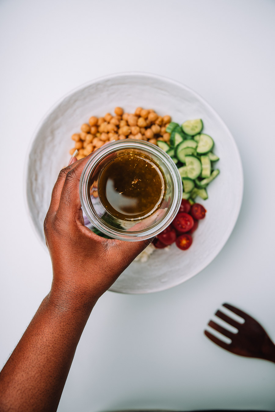 Bowl of Mediterranean Chickpea Salad on a white table