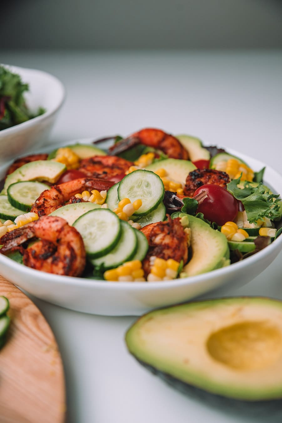 Bowl filled with Blackened Shrimp and Avocado Salad