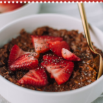 Looking to switch it up with a quick breakfast recipe? Make this easy healthy chocolatey thick batch of chocolate oatmeal made with chia seeds and topped with fresh strawberries. #chocolate #strawberry #oatmeal #breakfast