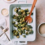 Oven roasted parmesan broccoli in a white baking pan on a table