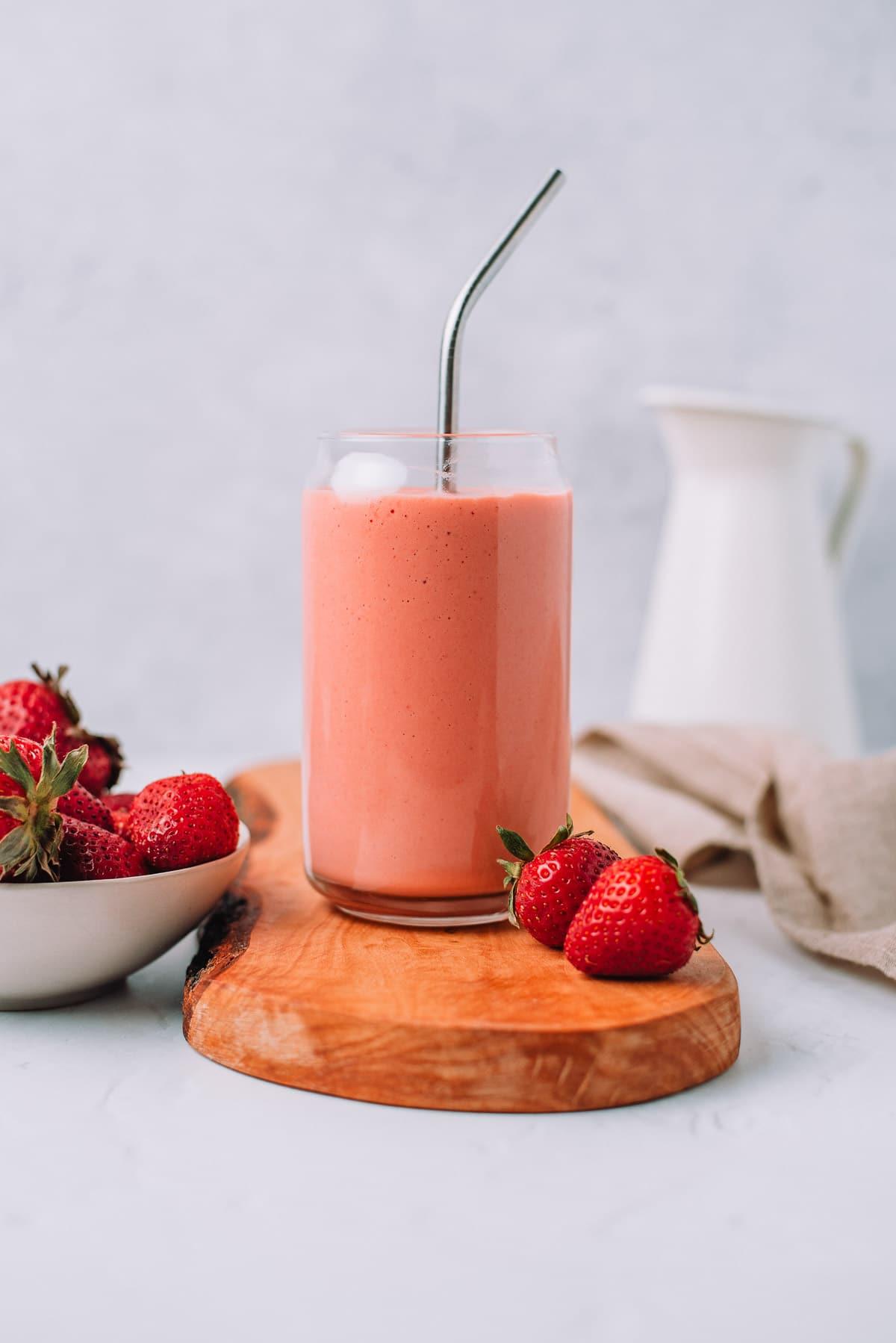 Strawberry Mango Smoothie in jar with metal straw