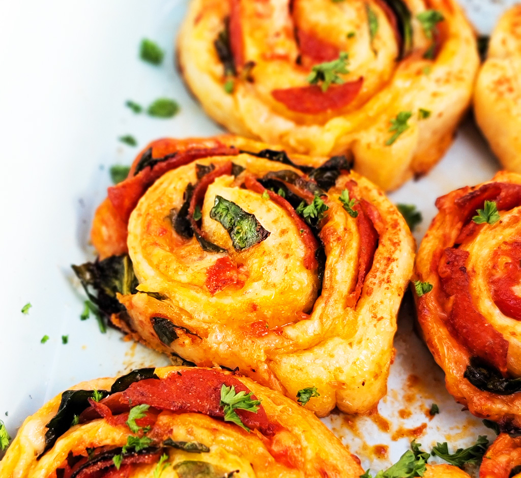 These Spinach & Pepperoni Pizza Rolls are filled with so much flavor and cheesy goodness; made with premade pizza dough. beautifuleatsandthings.com