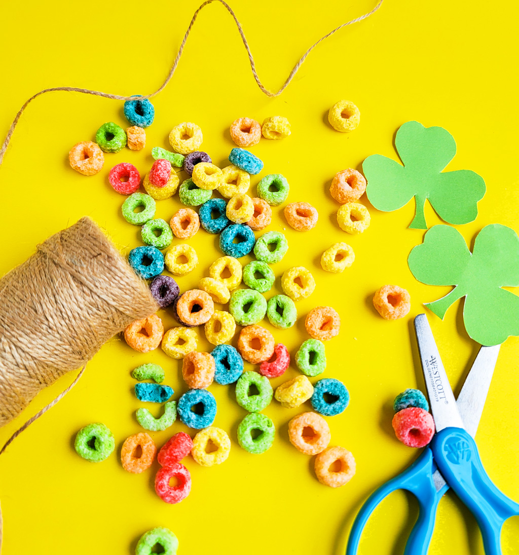 I've got you covered with this simple, fun craft: DIY St. Patrick's Day Shamrock Necklace made with fruit loops! Plus FREE St. Patrick's Day printables.  beautifuleatsandthings.com