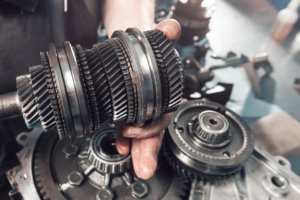 Car transmission being repaired by a mechanic in Cicero, Illinois