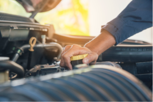 Mechanic changing the transmission fluid in a car in Chicago, Illinois