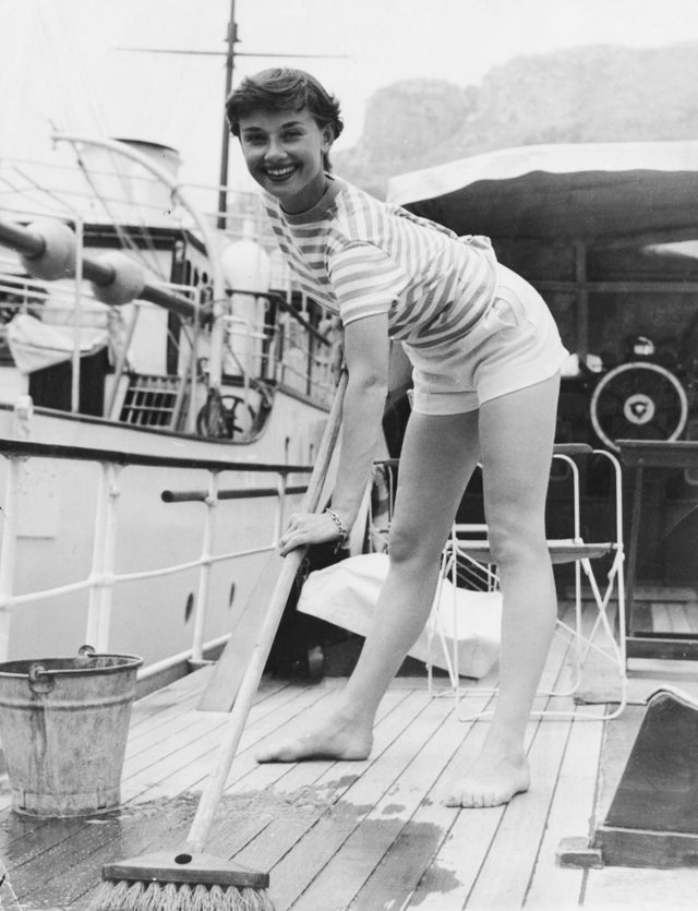 Audrey Hepburn cleaning a boat