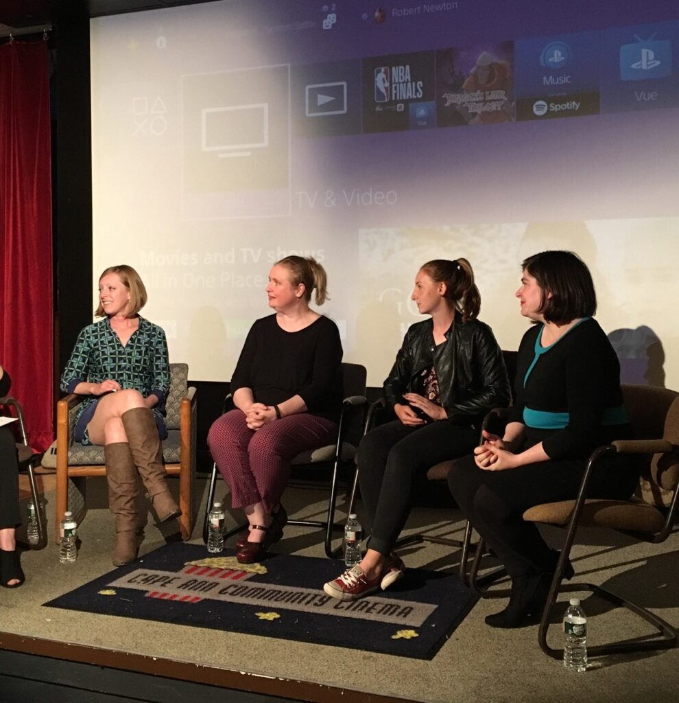 Photo of Hannah Bowen and four other speakers onstage at a Cape Ann Community Cinema event.