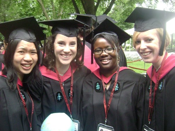 Photo of Hannah and three classmates in caps and gowns during graduation ceremonies