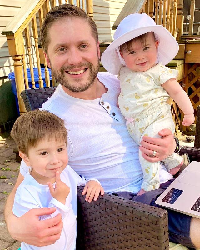 Man holding kids