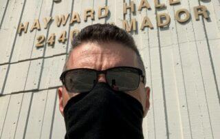 Edward Hugo wearing a face mask