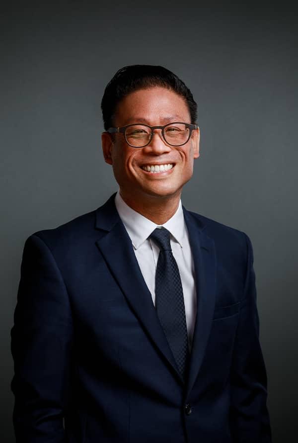 Paul S. Atigapramonj smiling