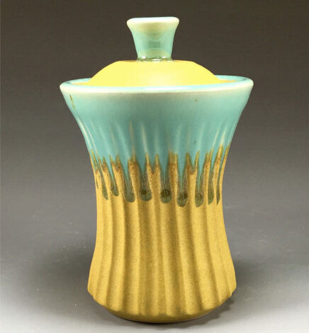Pottery Turquoise and gold jar with cover