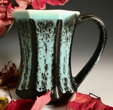 Black and aqua pottery mug