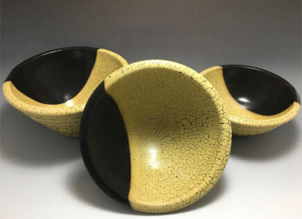 black and gold pottery bowls