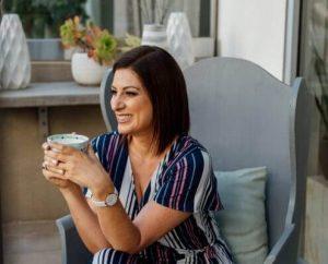 woman drinking tea in balcony