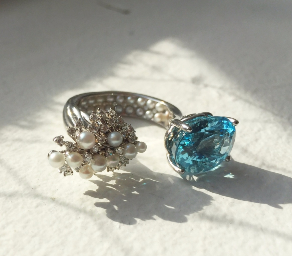 Open ring in 14k white gold with aquamarine, seed pearls (set inside the shank and atop), and diamonds by Christine Lloyd of Stuller; 337-262-7786; nichole_guillory@stuller.com