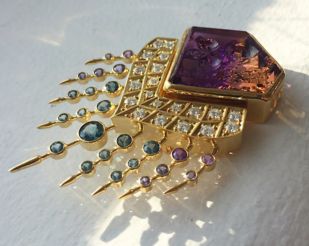 Goddess brooch in 18k yellow gold with a specialty-cut ametrine, blue-green sapphires, purple sapphires, and diamonds by Pheap Lorn-Canossi of Phenomenal Jewels; 626-731-3533; pheap@phenomenaljewels.com