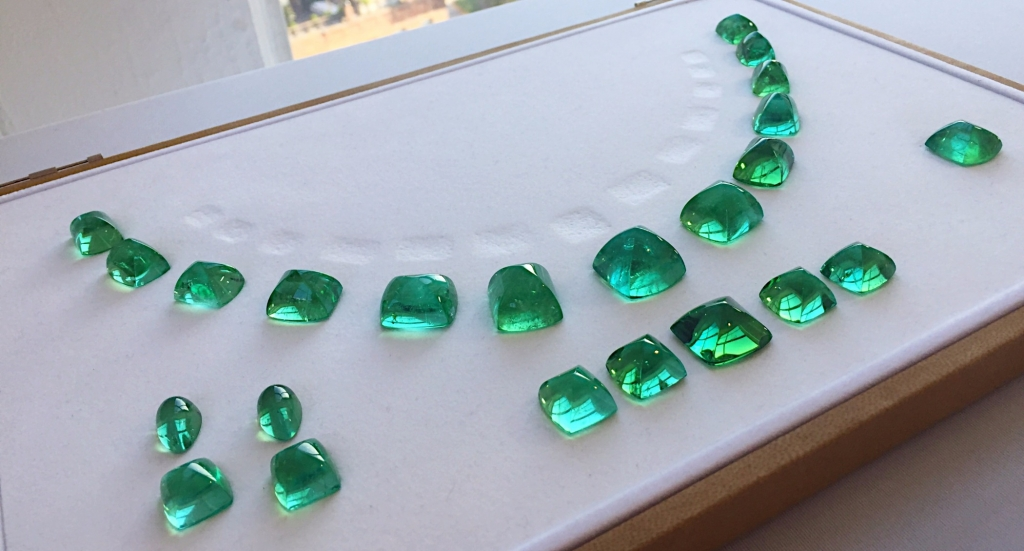 Suite of blue-green Sugarloaf-cut tourmaline by Mikola Kukharuk of Nomad's; 212-221-1207; tracy@gemsbynomad.com