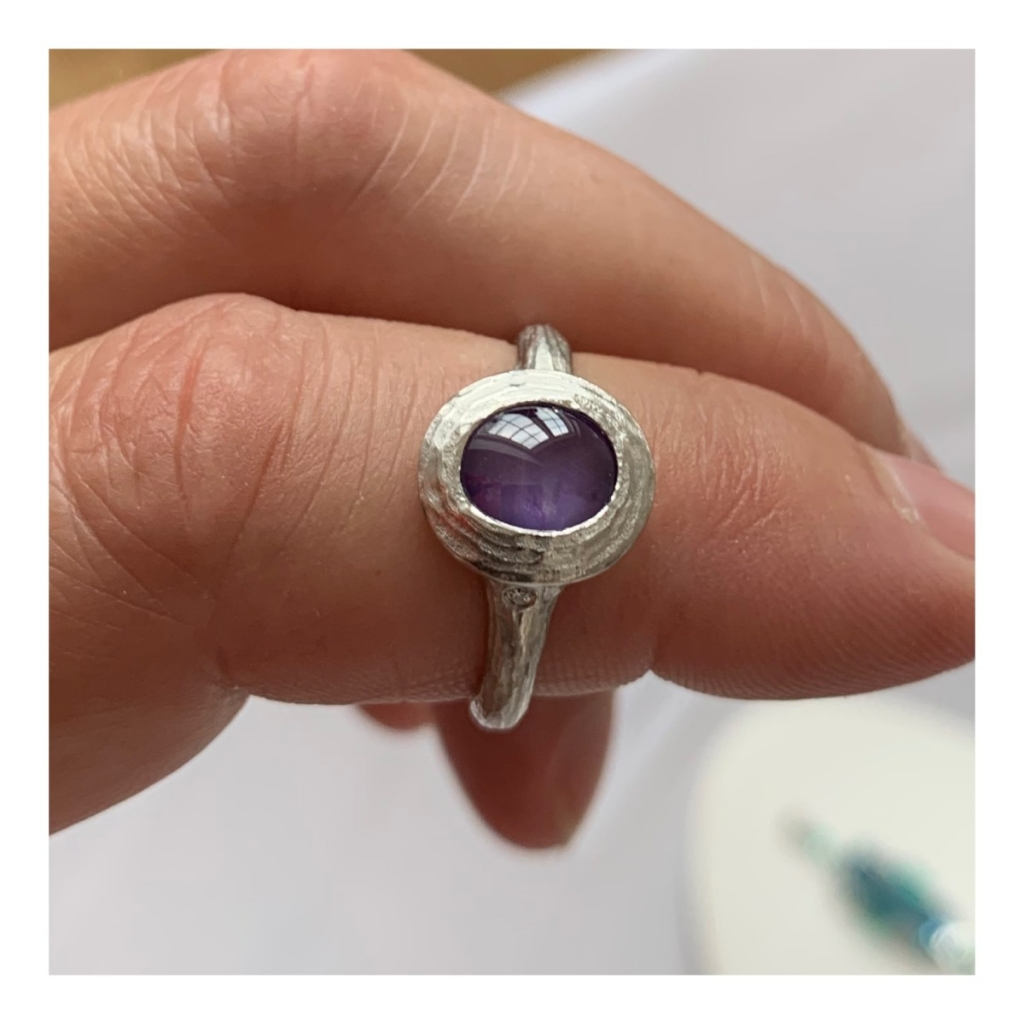 Little Lilac ring in platinum with a 1.85 ct. star sapphire and 2.36 cts. t.w. diamonds by Michael Endlich of Pave Fine Jewelry