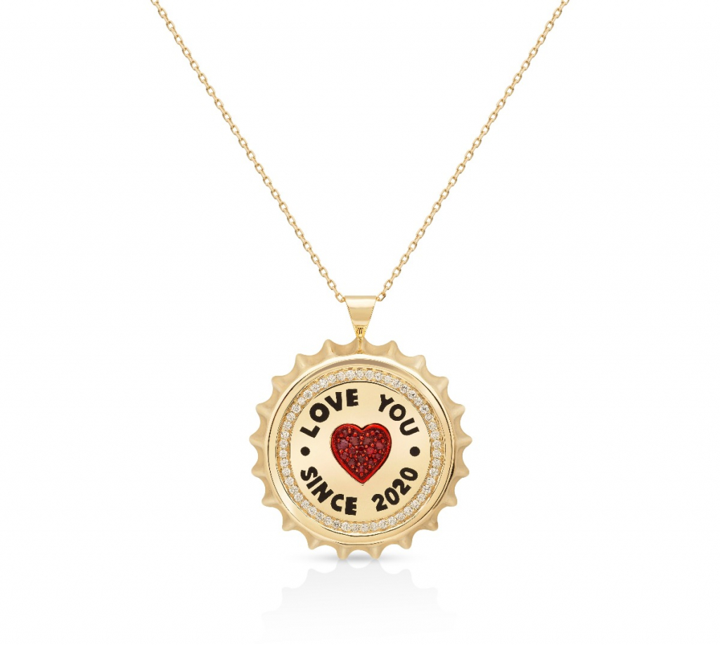 Fable Cap pendant necklace in 18k yellow gold with enamel and 0.335 ct. t.w. diamonds and 0.159 ct. t.w. rubies, $4,800; available online at Aisha Baker