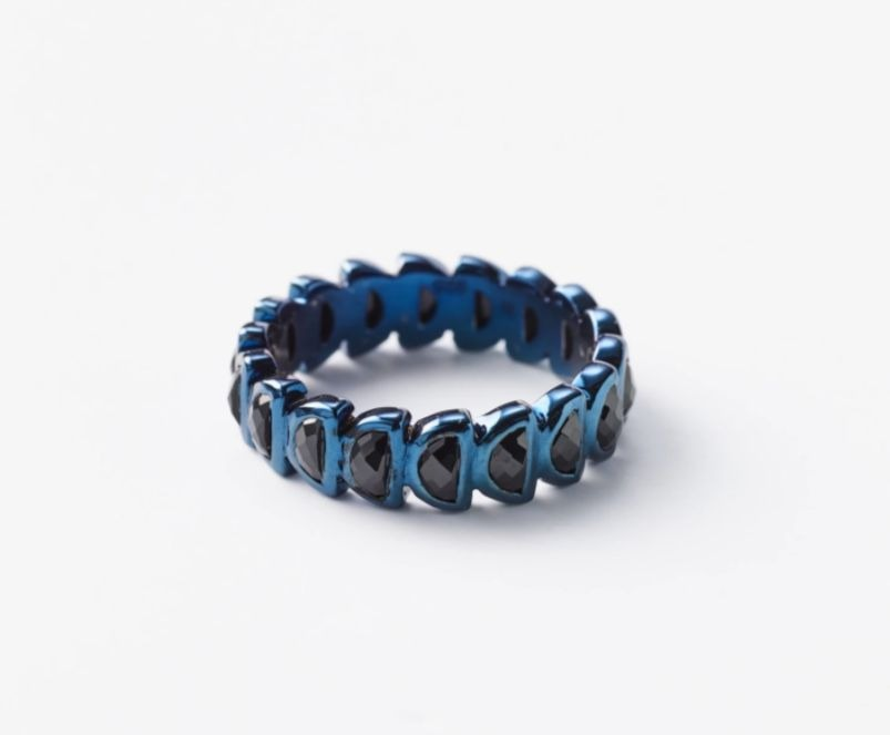 Worm band in sterling silver with a blue rhodium finish and half-moon-shape black spinel, $250; available online at Nak Armstrong