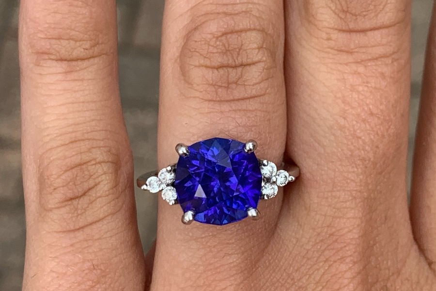 Rachel Dery's engagement ring: a 6.32 ct. cushion-cut tanzanite that her gem-cutting fiancé Björn cut from rough and heated himself.