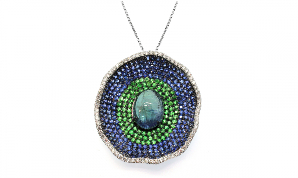 Blue Lagoon pendant necklace in 18k gold features 13.97 cts. t.w. if bi-color tanzanite cabochon, tsavorite and sapphires with 0.88 cts. t.w. diamonds, $7,920; Email studio@vivaan.us for purchase