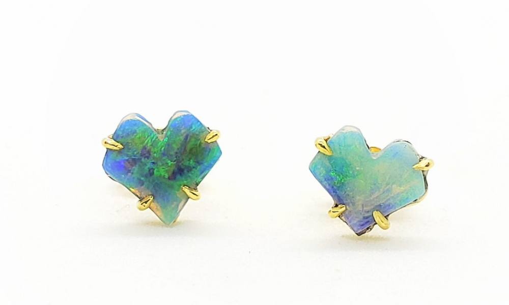 Stud earrings in 18k green gold with baby ginkgo leaf-shape Australian Lightning Ridge crystal opal custom cut by Liga Kaulina, $1,540; by Alison Nagasue available at Roseark