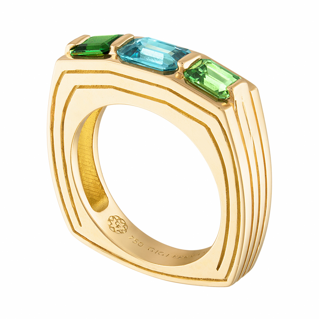 Portofino three-stone ring in 18k yellow gold with 1.22 ct. blue zircon and 0.98 cts. t.w. tsavorite garnets, $5,800; available online at Gigi Ferranti