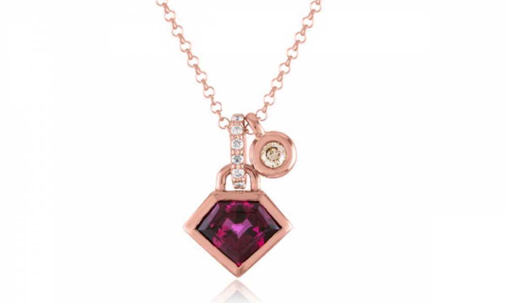 Red Garnet Birthstone Jewelry: Metropolis Super Charming necklace in in 14k rose gold on adjustable rolo chain with 1.45 cts. t.w. garnet, 0.13 ct. t.w. colorless diamonds, and 0.07 ct. t.w. champagne-color diamonds, $1,995; Email BeHerd@JulieLambNY.com for purchase