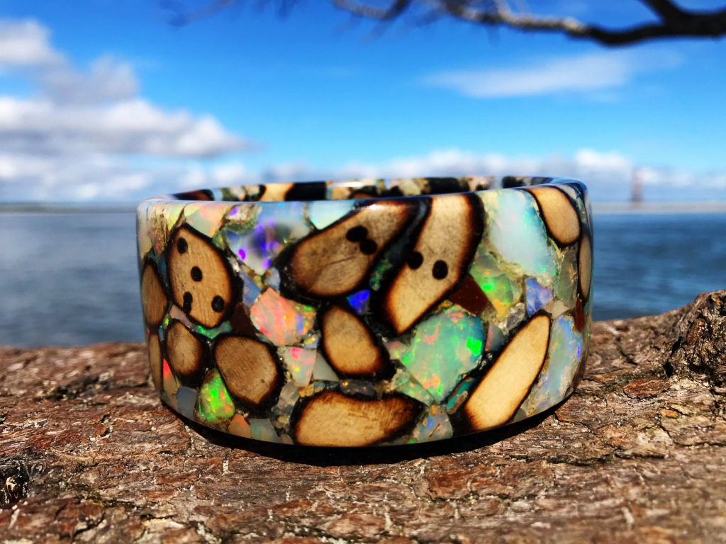 Jewelry Designer: Bangle in spalted holly wood with Ethiopian opal; DM @freestonepeach on Instagram for purchase info.