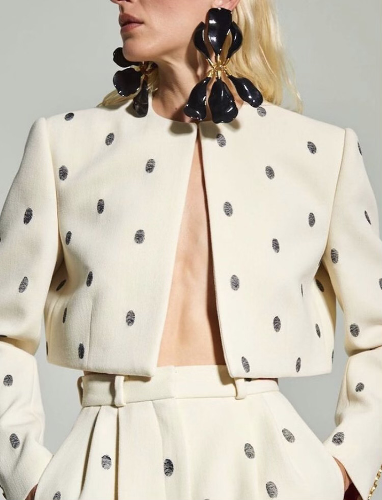 Couture Designer: A garment from Maison Schiaparelli's Fall-Winter 2020 season features fingerprint polka dots.