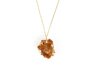 One-of-a-kind Raw pendant necklace in 18k yellow gold with uncut garnet and diamond accents, $2,900; available online at Ele Keats