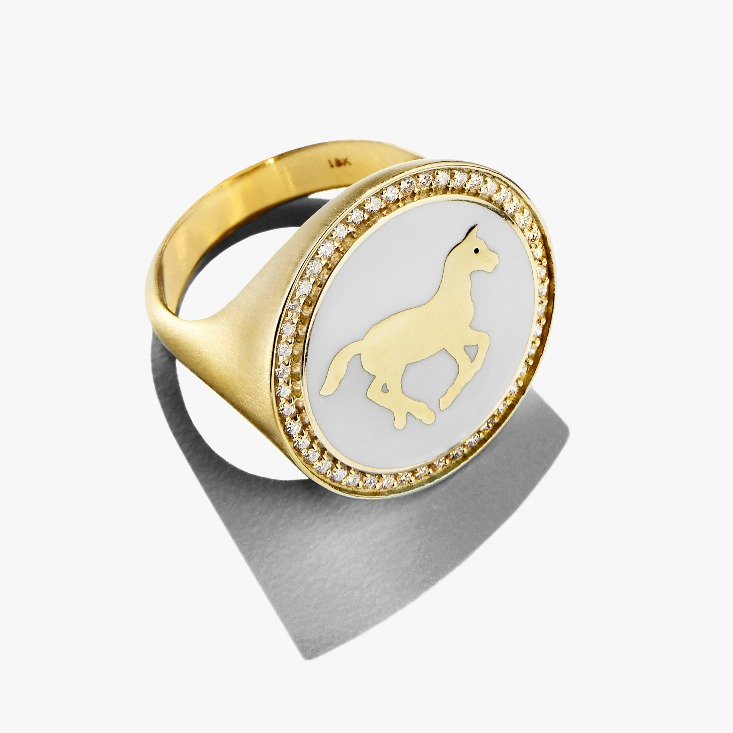 Signet ring in 18k yellow gold with white champlevé enamel and 0.28 ct. t.w. diamonds by Kristin Ohmstede; $8,495, email ko@kristinohmstede.com for purchase