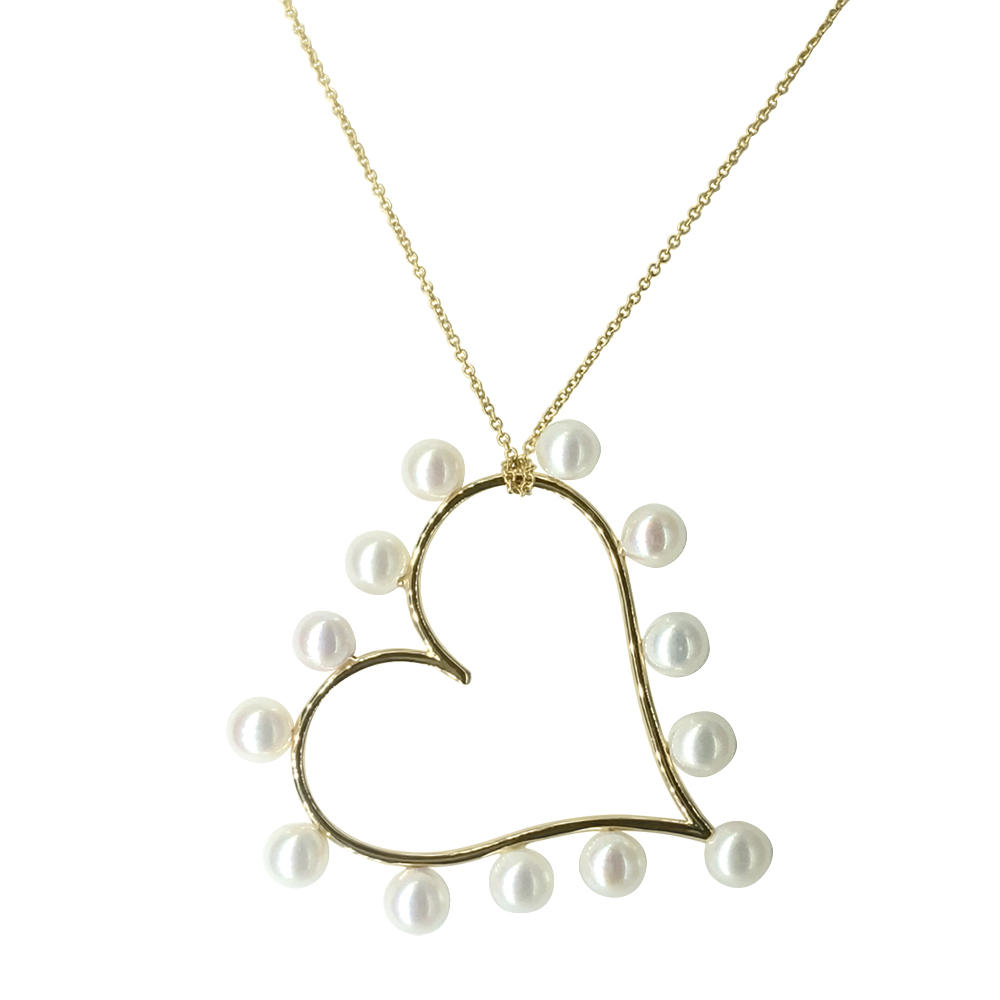 Tilted Heart necklace in 14k yellow gold with 6.5 mm cultured white freshwater pearls, $1,570; available online at Zales.com