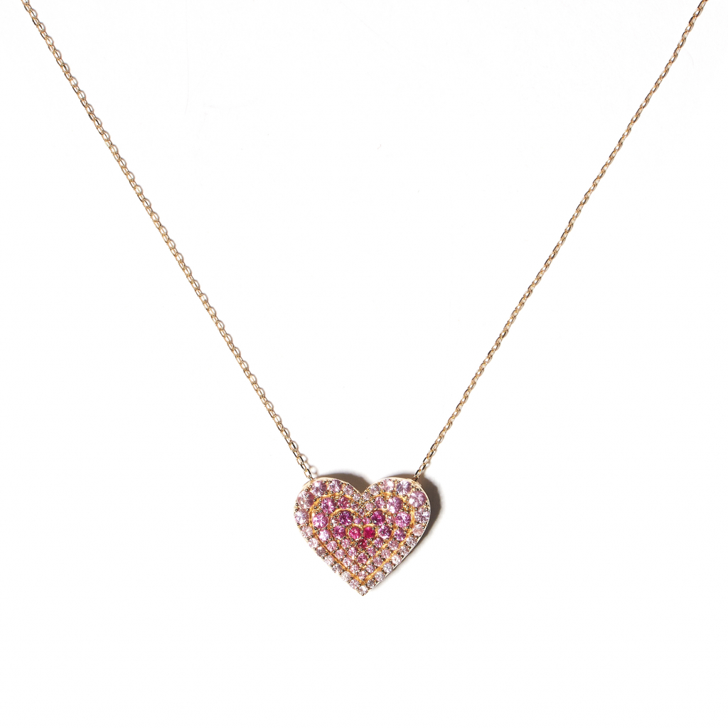 Juju heart charm necklace in 14k rose and white gold with 1.14 cts. t.w. pink sapphires and rubies, $3,840; available online at Campbell and Charlotte