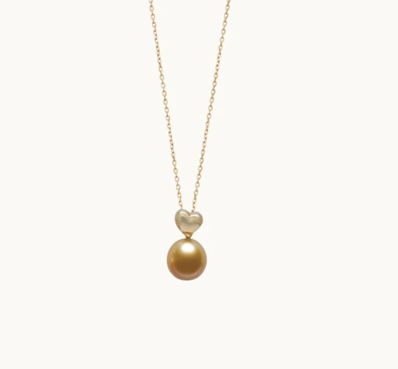 Petits Coeurs pendant (chain sold separately) in 18k yellow gold features an 11 to 11.5 mm natural-color golden South Sea pearl grown in the Philippines, $2,250; available online at Jewelmer