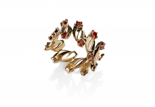 Comet ring in in 14k gold with Madeira garnet, $1,760; available online at Martha Seely
