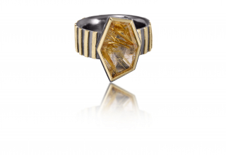 Stripe ring in 18k gold and oxidized sterling silver with rutilated quartz and a hand-fabricated, stipple-textured and engraved surface, $2,070; available online at Elizabeth Garvin